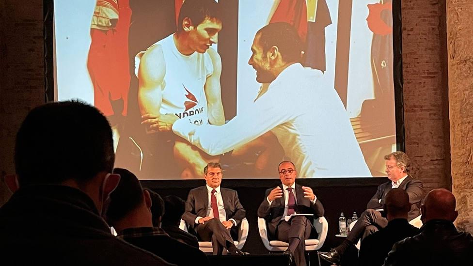 Una imagen de Messi y Guardiola, tras Joan Laporta, en un acto electoral (FOTO: @victor_nahe)