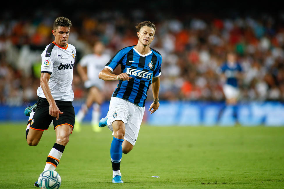 Gabriel Paulista of Valencia and Samuele Longo of Inter de Milan during the friendly football match played between Valencia CF and Inter de Milan at Mestalla Stadium in Valencia, Spain, on August 10, 2019.