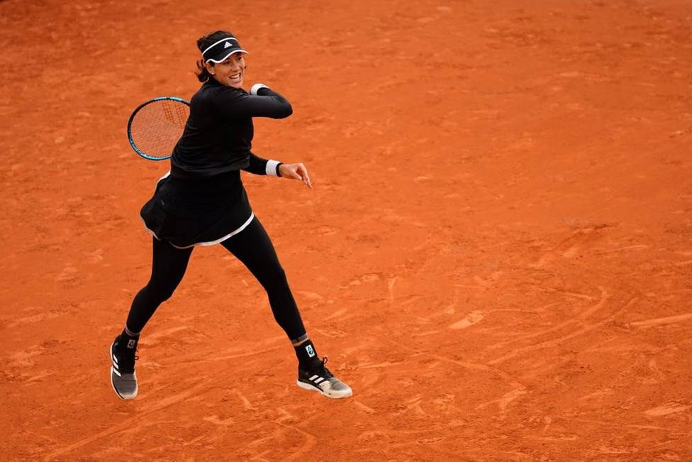 Tenis/Roland Garros.- Muguruza supera a Pliskova sin problemas y se mete en tercera ronda