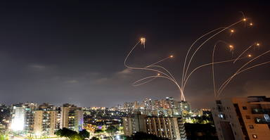 Streaks of light are seen as Israels Iron Dome anti-missile system intercepts rockets launched from the Gaza Strip towards Israel, as seen from Ashkelon