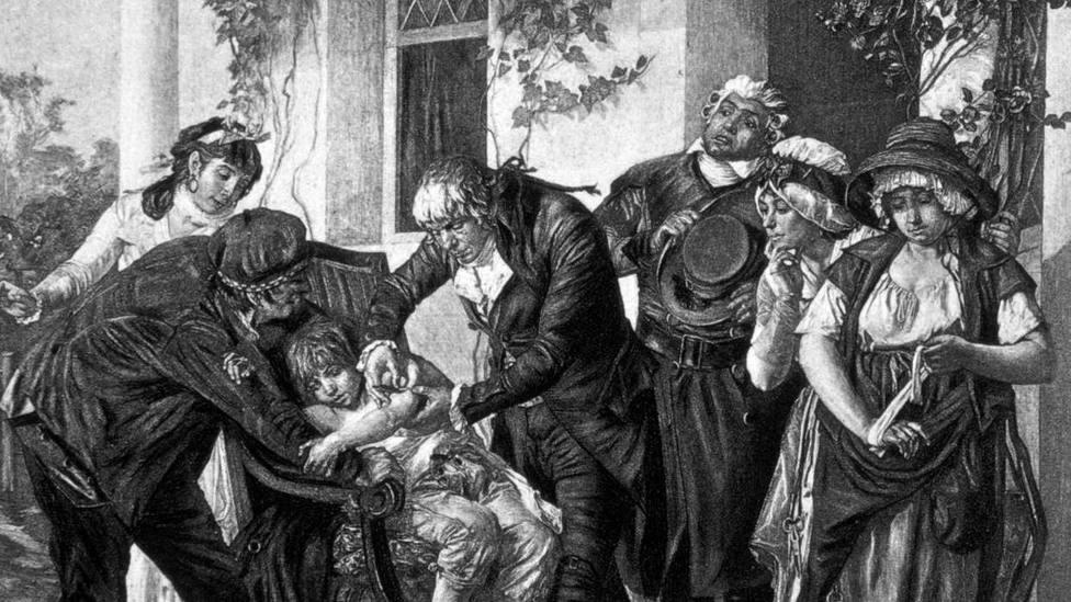 Grabado que muestra al doctor Edward Jenner vacunando al pequeño James Phillips
