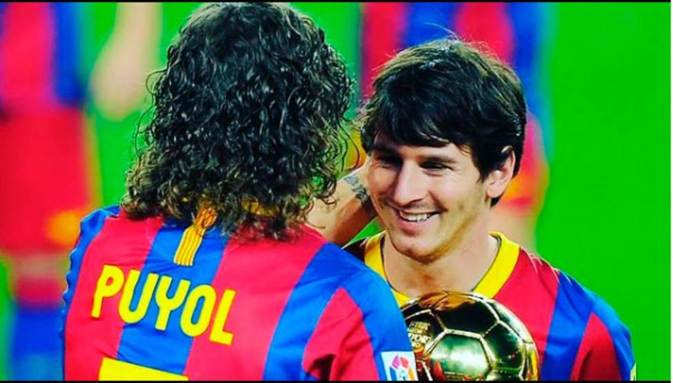 Carles Puyol y Leo Messi