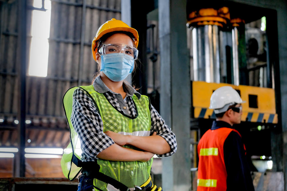 Factory,Woman,Worker,Or,Technician,With,Hygienic,Mask,Stand,With