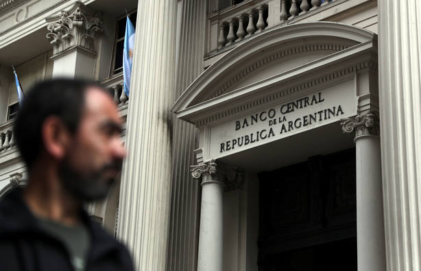 A man walks past Argentinas Central Bank in Buenos Aires financial district