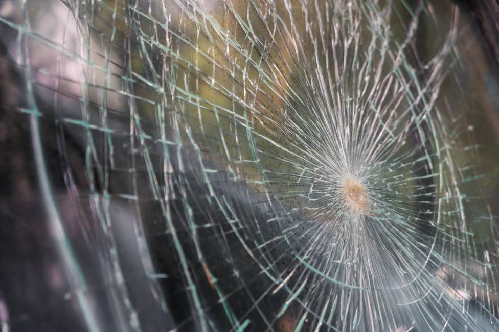 ctv-tek-glass-broken-cracks-splinters-in-front-of-car-filtered-image
