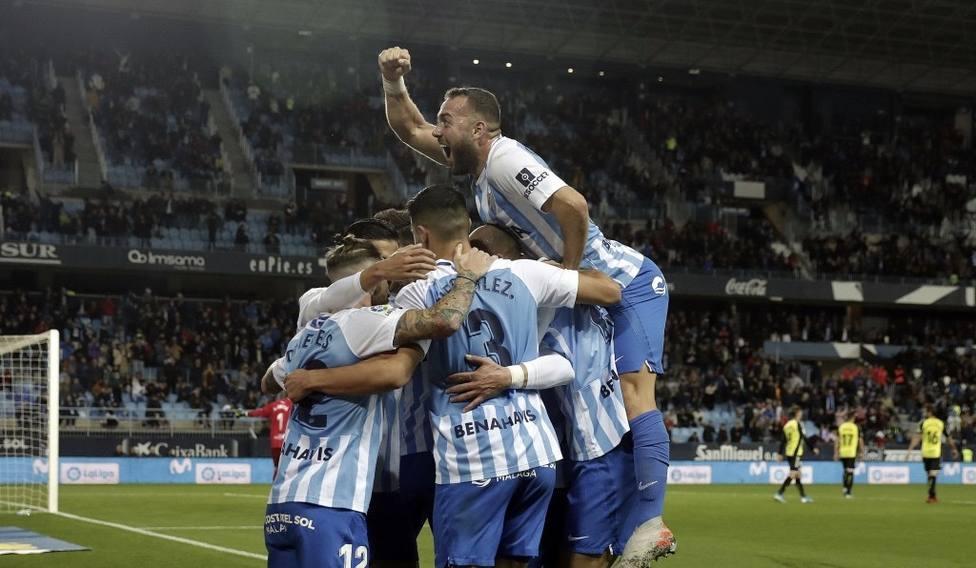 La imagen del partido, el Málaga una piña