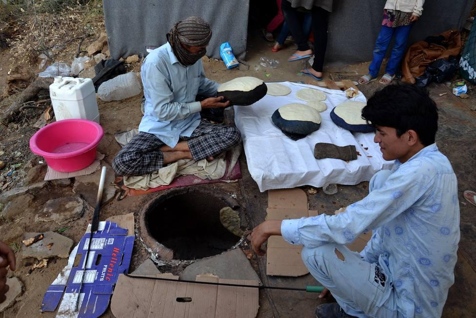 Migrants baking naan bread in Moria refugee camp, Lesvos island
