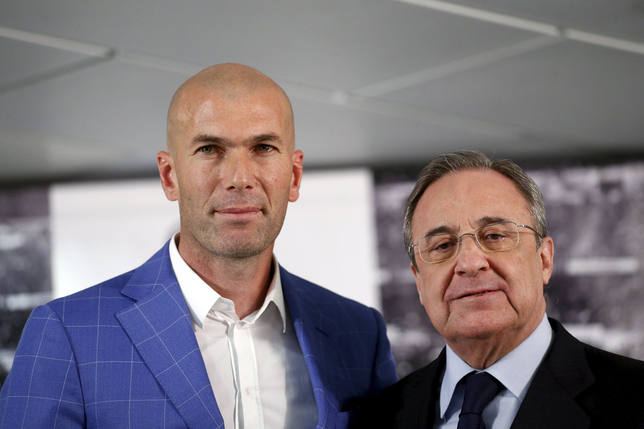 Real Madrids new coach Zidane and Real Madrids President Perez pose for the media at Santiago Bernabeu stadium in Madrid