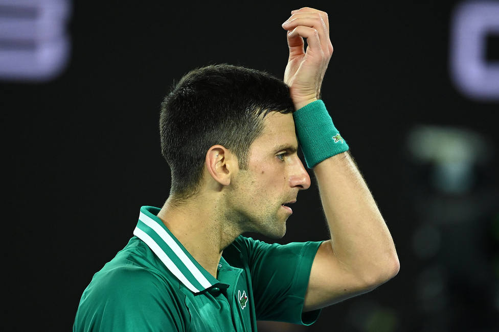 Novak Djokovic of Serbia reacts during his Mens Quarter finals singles match against Alexander Zverev of Germany on Day 9 of the Australian Open at Melbourne Park in Melbourne, Tuesday, February 16, 2021. (AAP Image/Dave Hunt) NO ARCHIVING, EDITORIA